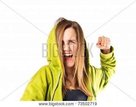 Girl Giving Punch Over Isolated White Background