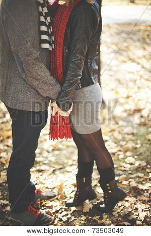 Young couple kissing in autumn park