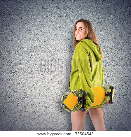 Skater With Green Sweatshirt Over Textured Background
