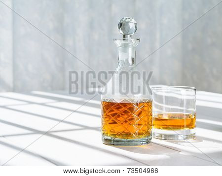 Whisky Decanter And Rocks Glass By The Window