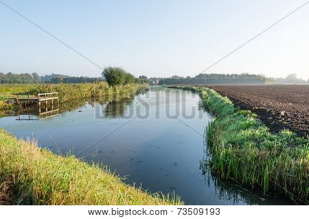 Small Stream With A Wooden Fishing Pier