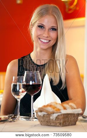 Beautiful Woman Sitting At A Table In A Restaurant