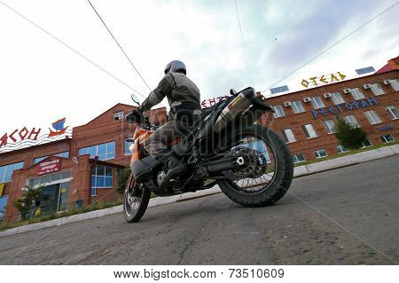 Buzuluk, Russia - October 6, 2010: An Unknown Man Biker Rides A Motorcycle In The City.