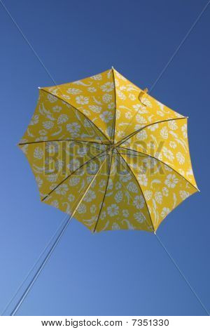 Yellow Umbrella In Blue Sky
