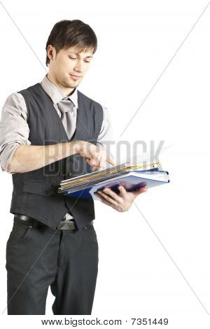 Young Businessman Looking At Files. Isolated