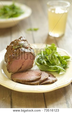 Baked veal with fresh salad