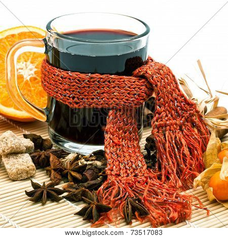 Cup Of Hot Wine And Spices On Cane Tray