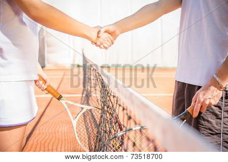 Handshake At Tennis Court After A Match