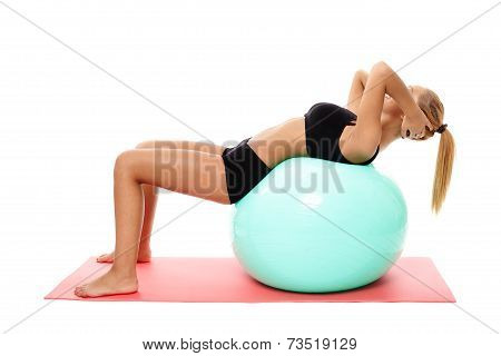 Fitness Girl Doing Abs On A Gym Ball