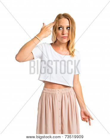Girl Making Suicide Gesture Over White Background