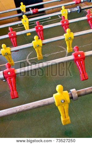 Foosball is a a game in which opponents on either side of a purpose-built table attempt to strike a ball into the other side's goal. Game played often in bars and game rooms.