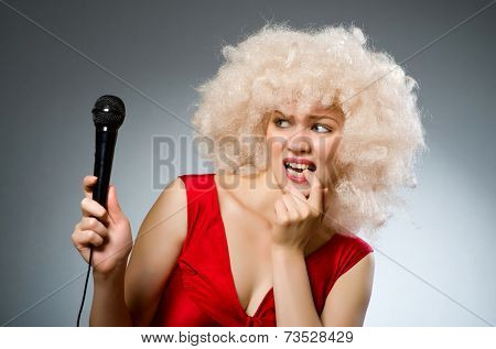 Musical concept with woman and mic