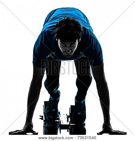 one  man runner sprinter on starting blocks in silhouette studio isolated on white background