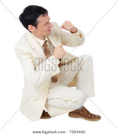 Businessman Sitting In Defensive Posture