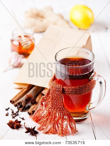 Cup Of Hot Tea With Cinnamon Sticks, Lemon And Star Anise
