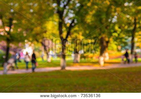 Natural Bokeh Background In The Autumn Park. Intentional Motion Blur.
