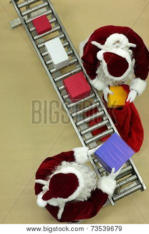 aerial view of two santa clauses working at conveyor belt in Christmas factory