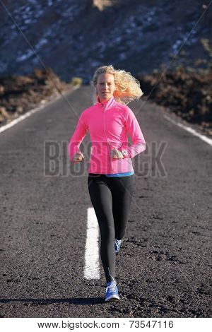 Running runner woman sport workout on mountain road. Jogging female fitness girl working out training for marathon on road in amazing nature landscape wearing warm clothing and running shoes.
