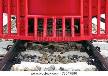 Red Bumper Of Diesel Train With Black Railway