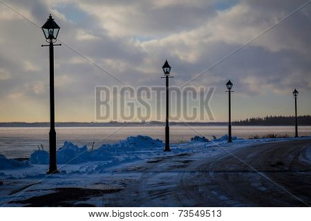 Roadway along a partially frozen harbour.