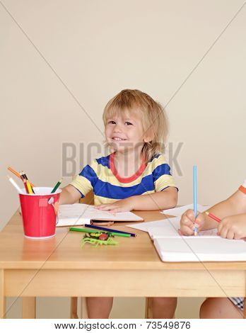Child Smiling At Art Class