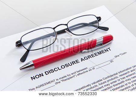 Non disclosure agreement with pen and glasses