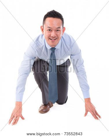 Asian business man on starting line of a race, front view full length isolated over white background.