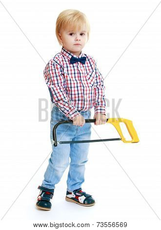 Little boy holding a hacksaw.