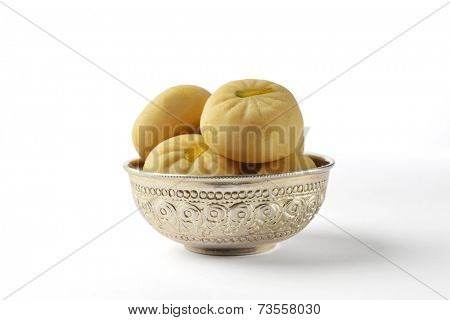 Pedha - a traditional indian sweet in a silver bowl. isolated image.