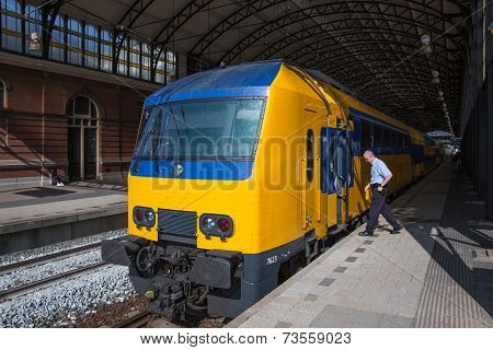 Conductor Getting In A Train Ready To Start In The Hague, The Netherlands