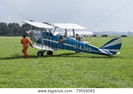 Historical Airplane With Pilot And Mechanics
