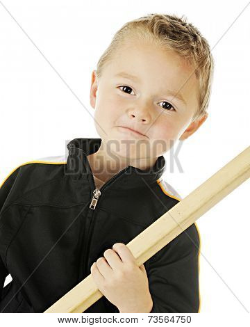 Close-up image of a young athlete wearing his sport jacket while holding his hockey stick.  On a white background.