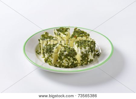 sliced chives chives on white plate