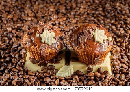 Chocolate muffin with chocolate and coffee beans
