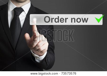 Businessman In Black Suit Pushing Button Order Now
