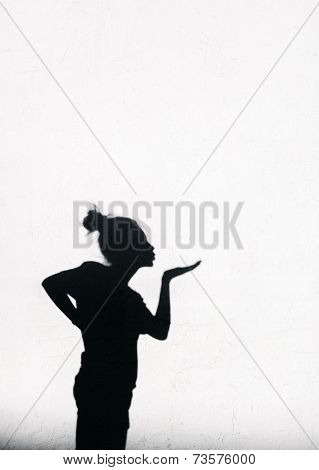 Girl Giving Air Kiss Around On White Wall Background