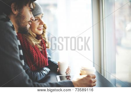 Young people looking at cafe window