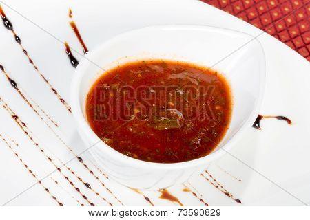 Spicy Tomato Sauce In A Gravy Boat White