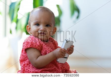 Portrait Of Little African American Little Girl Holding A Mobile Phone - Black People