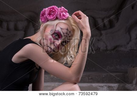 Portrait of a young girl in black dress with Calaveras makeup an