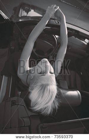 blonde girl in cabriolet fashion shot in bw