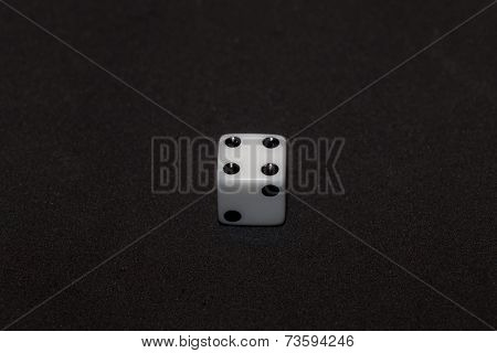 White Dice With Black Numbers In Black Background, Number Four