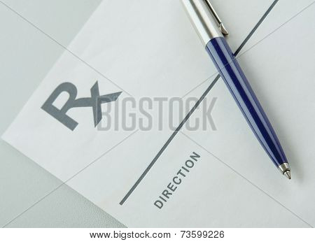 A blue pen on a rx prescription.