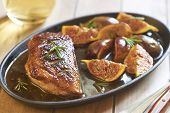 stock photo of duck breast  - Roasted duck breast with figs and rosemary in wine sauce