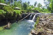 stock photo of samoa  - Exotic waterfall on the island of Upolu in Samoa - JPG