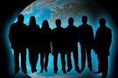 stock photo of por  - Business team silhouettes  against blue  globe background - JPG