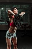 picture of swing  - Fitness woman swinging kettle bell at gym - JPG