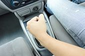 picture of gear-shifter  - man hand on manual gear shift knob - JPG