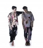 foto of zombie  - Two male zombies standing on white background full body shot looking away - JPG