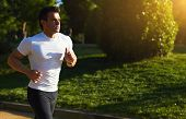 pic of strongman  - Male runner doing workout outdoors - JPG